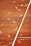 Footsteps on a Clay Tennis Court Royalty Free Stock Images