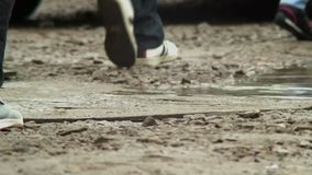 Footsteps on a dirty surface, tropical Asia storm aftermath. Stock footage stock video footage