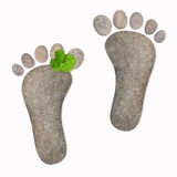 Footsteps with four leave clover Royalty Free Stock Photos