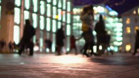 Footsteps of many people walking at urban square, active night life in big city. Stock footage stock video