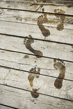 Footsteps on a pier. Closeup Royalty Free Stock Images