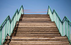 Footsteps and prohibiting red and white tapes Stock Image