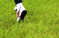 Footsteps of Running Woman Over the Green Grass. Running Shoes C Royalty Free Stock Image