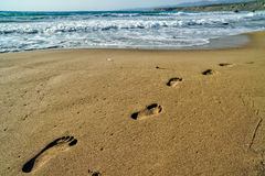 Footsteps on the sand. Beach Royalty Free Stock Images