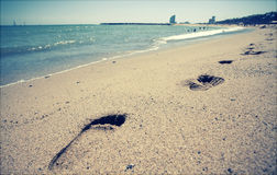 Footsteps in the sand Stock Photo