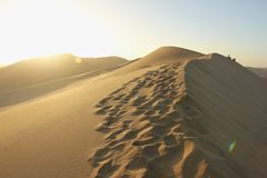 Footsteps on the Sand Dunes Stock Photo