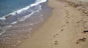 Footsteps in the sand - retro photo Royalty Free Stock Photos