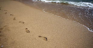 Footsteps in the sand - retro photo Stock Photo