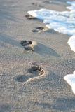 Footsteps in the sands suggesting new life paths Royalty Free Stock Photo