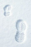Footsteps in snow Stock Images