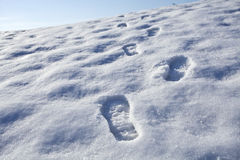 Footsteps in snow. Beautiful landscape Royalty Free Stock Photos