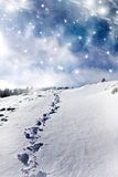 Footsteps in the snow in the mountains Royalty Free Stock Images