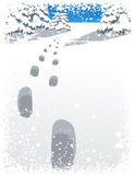 Footsteps and snowfall in the winter forest Stock Photo