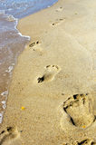 Footsteps at sunset time Royalty Free Stock Image