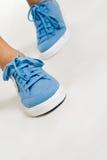 Footwear. Trendy sport footwear on woman legs Royalty Free Stock Photography