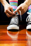 Footwear. Close up of a teenager tying his footwear royalty free stock photo