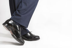 Footwear Concept: Closeup of Stylish Black Shiny Male Semi-Brogu Royalty Free Stock Images