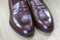 Footwear Concept and Ideas. Men's Stylish Brown Penny Loafers Toe Tips. Closeup. Horizontal Image Royalty Free Stock Images