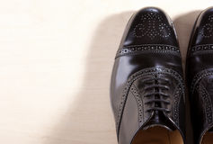 Footwear Concept. Pair of Black Fashionable Male Oxfords Semi-Br Royalty Free Stock Images