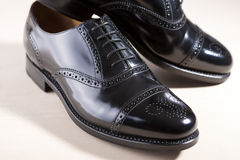 Footwear Concept. Pair of Black Fashionable Male Oxfords Semi-Br Royalty Free Stock Photography