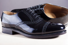 Footwear Concept. Pair of New Black Stylish Male Oxfords Laqured Royalty Free Stock Image