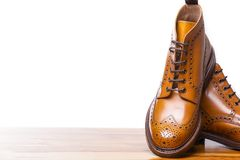 Footwear Concepts.Closeup of Pair of High Gentleman Tanned Brogues stock image