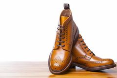 Footwear Concepts.Closeup of Pair of High Men`s Tanned Brogues Royalty Free Stock Photography