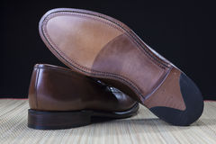Footwear Concepts and Ideas. Backside View of Penny Loafer Natural Leather Sole Royalty Free Stock Image