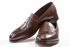 Footwear Concepts. Leather Stylish Brown Penny Loafer Shoes Stock Image