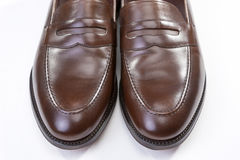 Footwear Concepts. Pair of Stylish Brown Penny Loafer Shoes Agai Royalty Free Stock Images