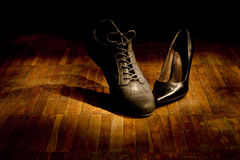 Footwear dance: love. Shoes on an old parquet Royalty Free Stock Image
