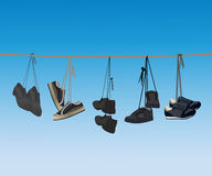 The footwear hanging on a rope. Royalty Free Stock Images