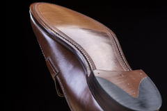 Footwear Ideas. Downward Side of Penny Loafer Natural Leather Sole. Royalty Free Stock Photos