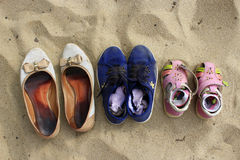 Footwear left by mother and her daughters Stock Photography