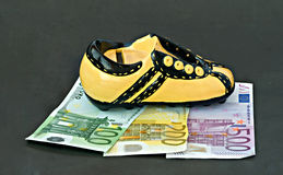 Footwear the money bank. Isolated on black background Stock Photos