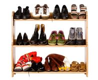 Footwear on regiments. Shoes,  gym shoes, boots and other footwear stand on a rack Stock Photo