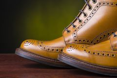 Pair of premium tanned brogue derby boots. Footwear and shoes concepts. Pair of Premium Tanned Brogue Derby Boots Made of Calf Leather with Rubber Sole. Shoot royalty free stock photos