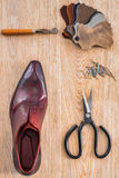 Footwear on a wooden background with equipment Stock Photography