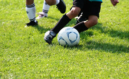 Footwork action. Soccer field action with feet in motion stock photos