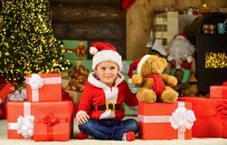 Free For Santa. Happy Child Santa Hat. Son Ready To Celebrate Winter Holidays. Small Boy Excited With Present. Kid Hold Royalty Free Stock Photos - 203467918