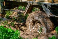 Fora da roda da estrada colada na lama Imagem de Stock Royalty Free