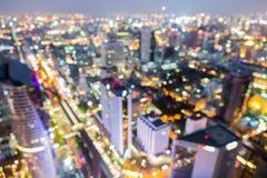 Fora das luzes grandes da cidade do foco, bokeh borrado da foto Fotografia de Stock