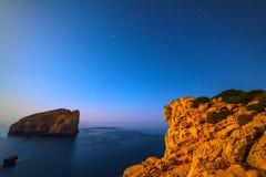 Foradada island under a clear sky at night. Sardinia, Italy Royalty Free Stock Photography