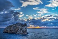 Foradada island under a cloudy sky Stock Photography