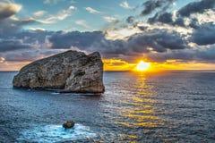 Foradada island under a cloudy sky at sunset Stock Photo