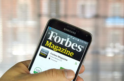 Forbes Magazine app. MONTREAL, CANADA - MARCH 20, 2016 - Forbes Magazine application on Samsung S5's screen. Forbes is an American business magazine, published Stock Image