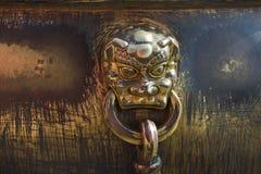 Detail of artifact inside the Forbidden City Beijing. The Forbidden City in Beijing China showing details of an of gilded lion artifact Stock Photos