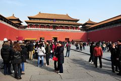 The Forbidden city in Beijing China. Tourists at entrance gate of the Forbidden City in Beijing, China. It`s China`s best-preserved imperial palace and is known royalty free stock images