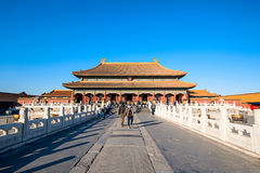 Forbidden City in a sunny day. Beijing, China - December 25, 2014: Tourists visit Forbidden City Royalty Free Stock Image