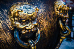 The Forbidden City Tongding lion. Handle royalty free stock photo